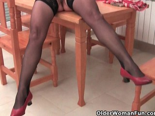 Granny in black stockings masturbates her hairy pussy with dildo