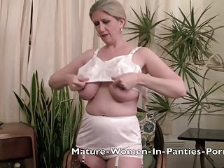 Mature Tits Sway as She Gets Dressed in Vintage Underwear