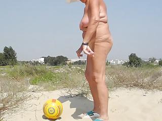 Nude on the beach ball