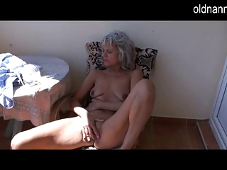 Naughty older mature masturbating with toy