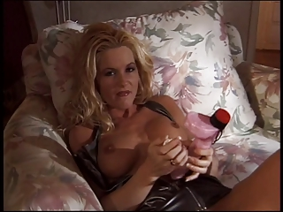 Blonde masturbates while home alone at night