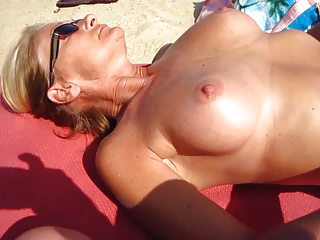 Wife wanks me on the beach