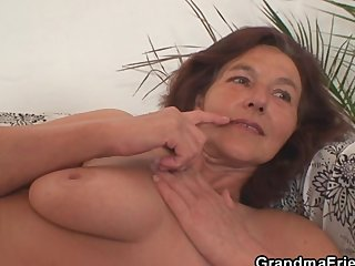 Grandma enjoys two youthful cocks