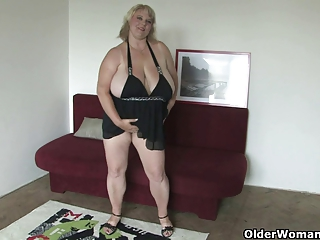 Mature BBW with oversized tits fucks herself with dildo