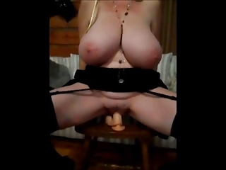 Busty MILF rides her toy