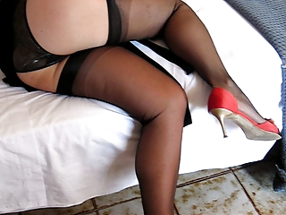 Filming her legs in black stockings