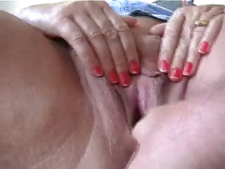 Fingering a wet granny pussy
