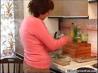 Over 60 granny fucks a bottle