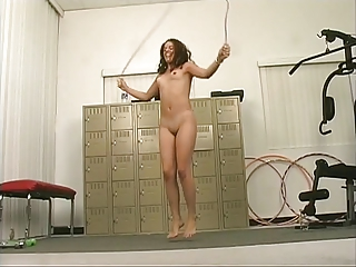 Lusty brown-haired with cute tits plays with herself at gym