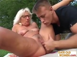 Grandma fucks youthfuler guy outdoors
