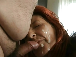 Redhead mature in stilettos gets BIG facial from hubby.