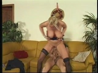 Blonde mature with great tits in action