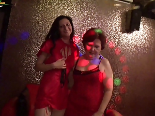 Granny and youthful girl in the swinger party