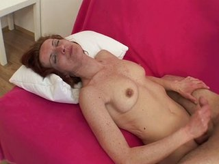Mature Redhead on Couch