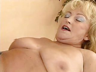 Busty and chubby granny fucked by a bald guy.