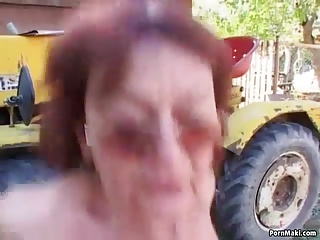 Redhead granny fucked in the back yard