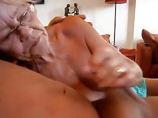 Granny wanks him and sucks