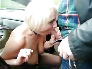 Old street prostitute serves customer outdoor