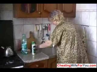 Short hair Russian mom in the kitchen