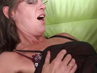 Granny in black stockings gets fucked hard on sofa