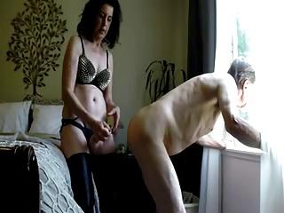 Wife fucks husband ass by the window