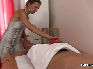 Mature masseuse sucks and rides young meat