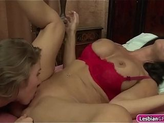Huge-chested cougar eats her black-haired girlfriends poon