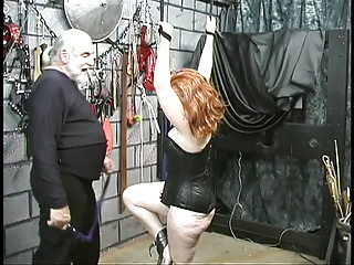 Curvy red head gets arms bound above her head