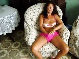 Wife with hand in pants masturbates to orgasm
