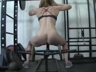 Bulky gal red-haired pummels fake penis in Gym