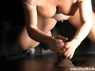 Dark haired hot mom goes to a local gloryhole to fulfill her fantasy of sucking strangers cocks