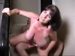 Huge-titted wifey on the stairs