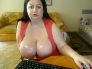 Plump cougar with yam-sized sweat-soaked hooters
