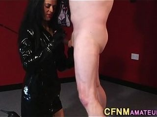 Fetish dressed cougar wanks
