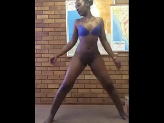 Dark-hued lady dance twerk nude