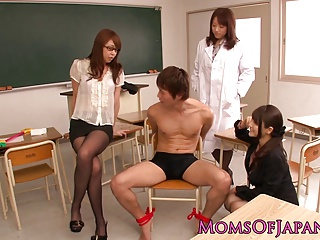 Young Japanese MILF teachers share cock in classroom