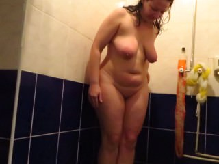 adult woman standing in the shower pissing